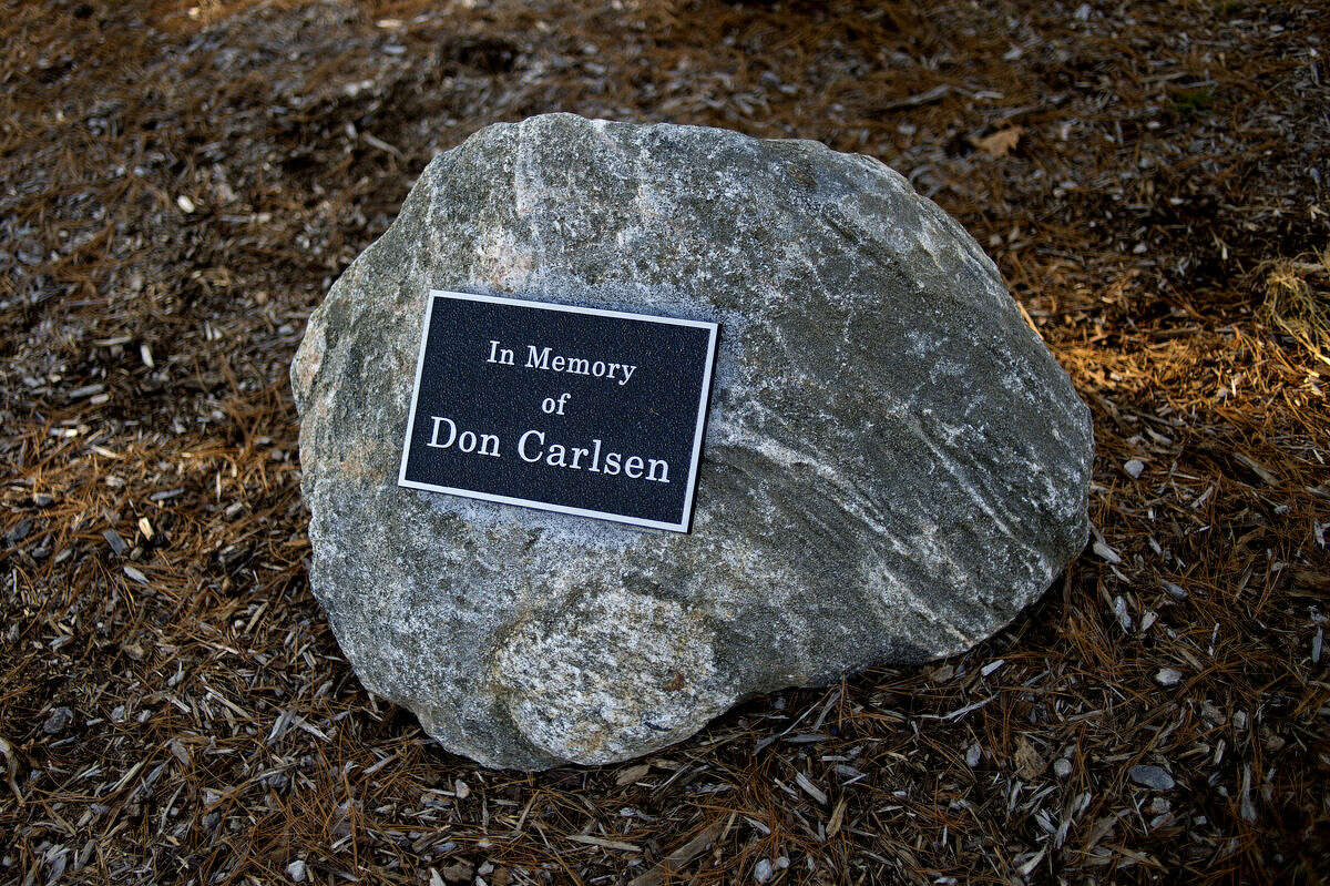 A stone that Harry and Helen Grether along with Don Carlsen's wife, Janet, have set up as a memorial to Don Carlsen, who used to own the property on that Midland Lincoln Ford stands and was very influential in developing it.