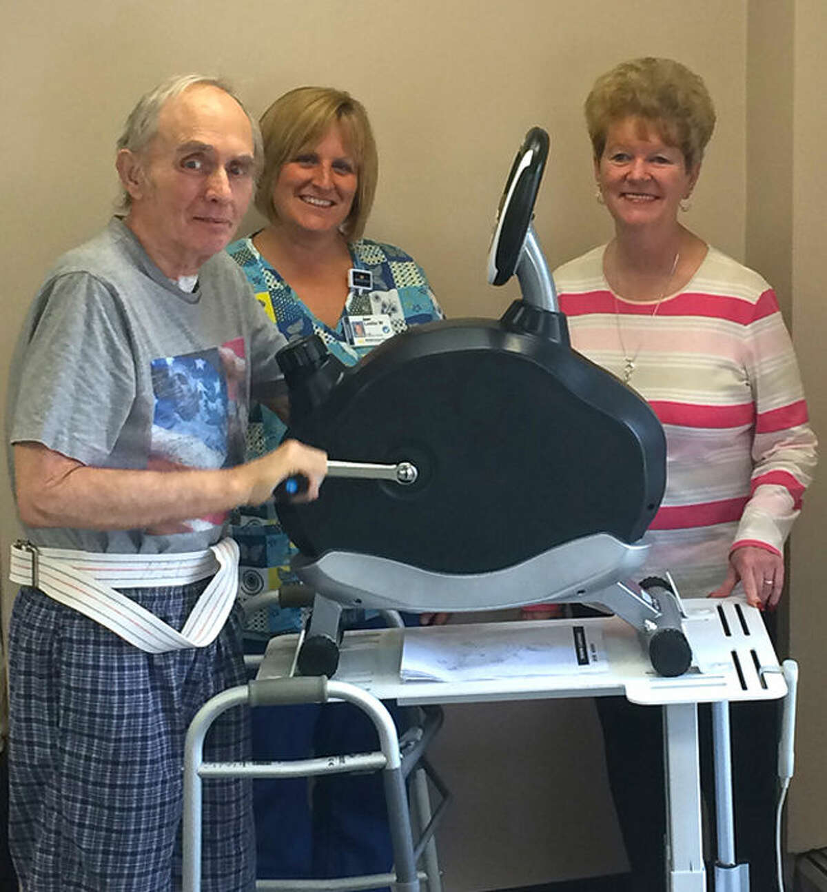 Pictured with the new equipment are Michael Howard, MidMichigan Gladwin Pines resident; Leslie Worden, physical therapist assistant; and Pat Murney, president of the Fraternal Order of Eagles Retired Activity Club.
