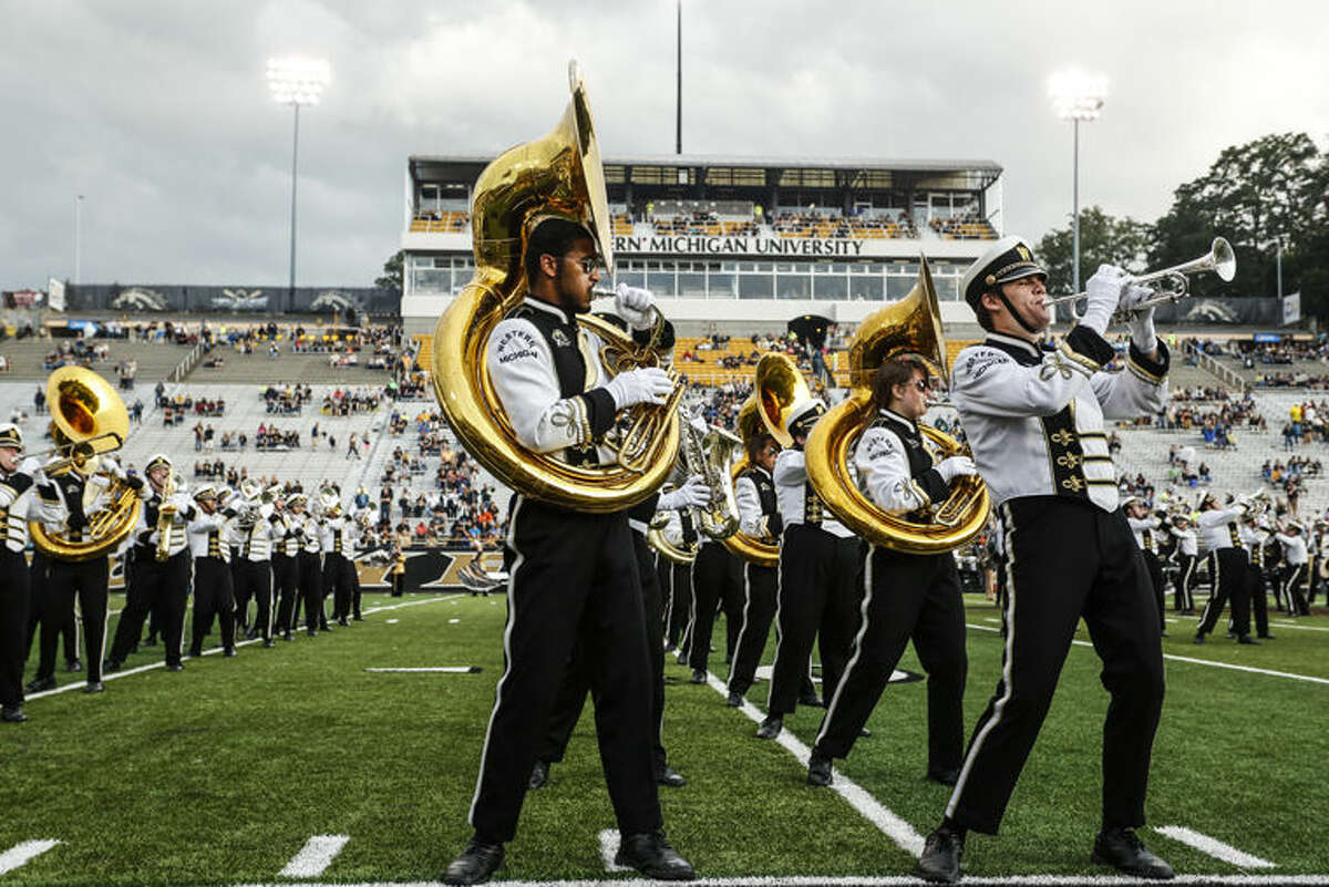 FILE -- In this Sept. 20, 2014, file photo, the Western Michigan marching band performs before an NCAA college football game in Kalamazoo, Mich. Marching bands and cheerleading squads are so much a part of college football's pageantry that many bowls strongly recommend or even require their presence, but financial and logistical hurdles will prevent some bands and cheerleaders from making trips to college football's more exotic postseason locales. The Western Michigan band and the Middle Tennessee band will not be making the trip to the Bahamas Bowl. (Junfu Han/Kalamazoo Gazette-MLive Media Group via AP, File)