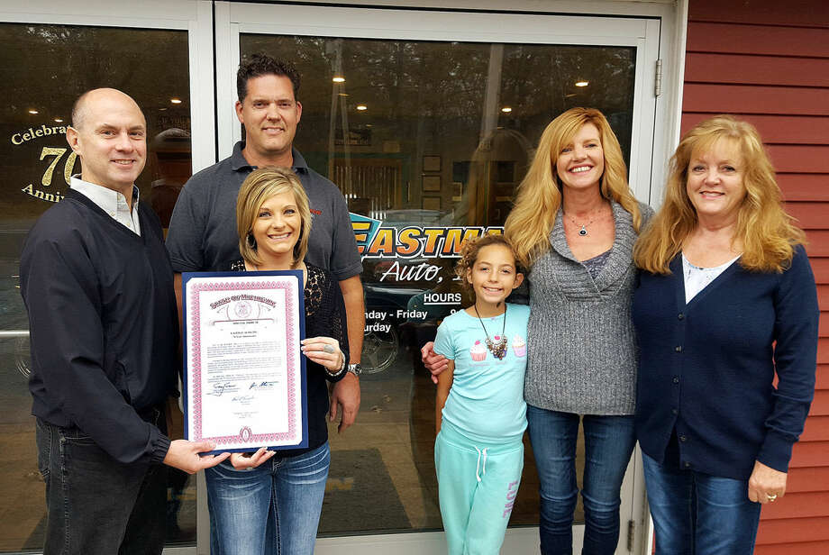 Rich Eastman poses with Rep. Gary Glenn, left, along with others after receiving a State of Michigan certificate celebrating Eastman Auto's 70th anniversary. Photo: Photo Provided