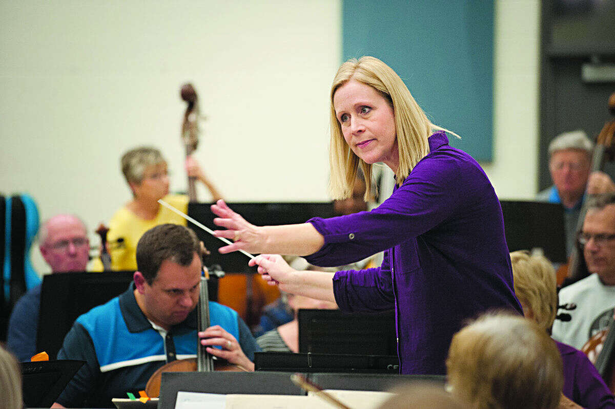 STEVEN SIMPKINS | for the Daily News Midland Community Orchestra during rehearsal Monday evening. Gina Provenzano, an Alma professor, is taking over the reigns as the conductor.