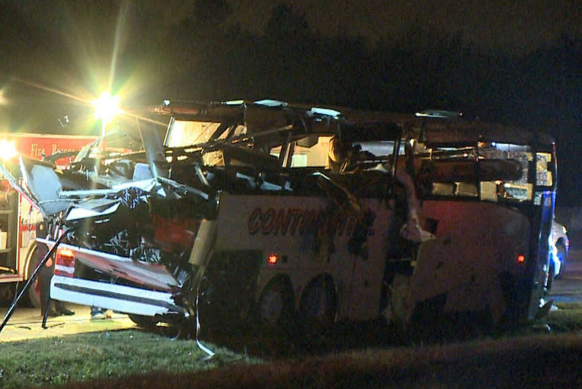 This photo provided by KTHV in Little Rock shows a charter bus damaged after it ran off Interstate 40 and hit a bridge abutment on Friday, Nov. 6, 2015 in North Little Rock Ark. Some passengers were killed in the crash along with several injuries. A heavy storm had recently passed through the area and left light rain and fog in its wake, but it wasn't immediately known if weather played a role. (Photo courtesy of KTHV via AP) MANDATORY CREDIT