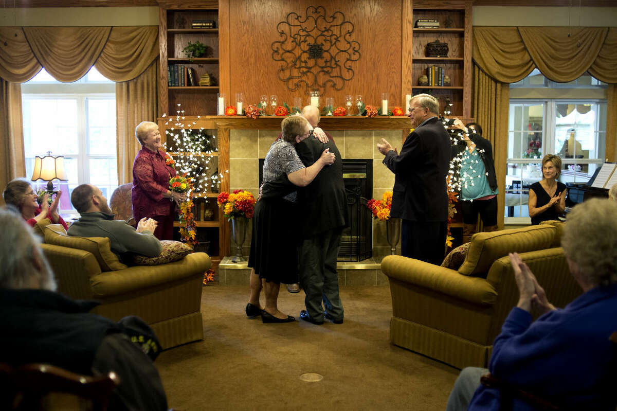 BRITTNEY LOHMILLER   blohmiller@mdn.net Katherine and Jack Moore hug at the end of their vow renewal ceremony on their 43rd wedding anniversary at Bickford Senior Living Wednesday afternoon.