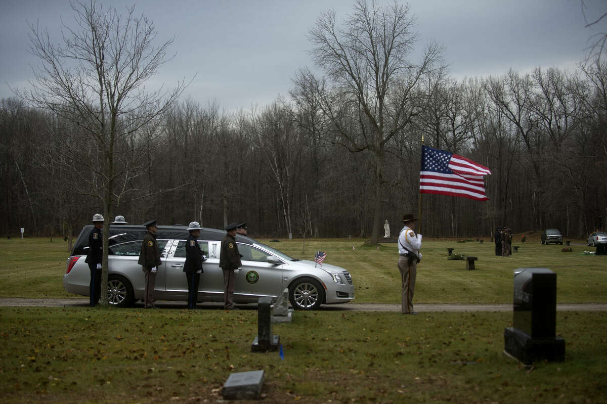 BRITTNEY LOHMILLER   blohmiller@mdn.net The hearse carrying Columbia, S.C. Police Officer Stacy Case waits for the color guard to assemble at the Midland Memorial Gardens cemetery Wednesday morning. Officer Case grew up in Sanford and graduated from Meridian High School in 1996. After high school graduation, she joined the U. S. Army from 1996 to 2011, where she served in the Army's Military Police Corps.
