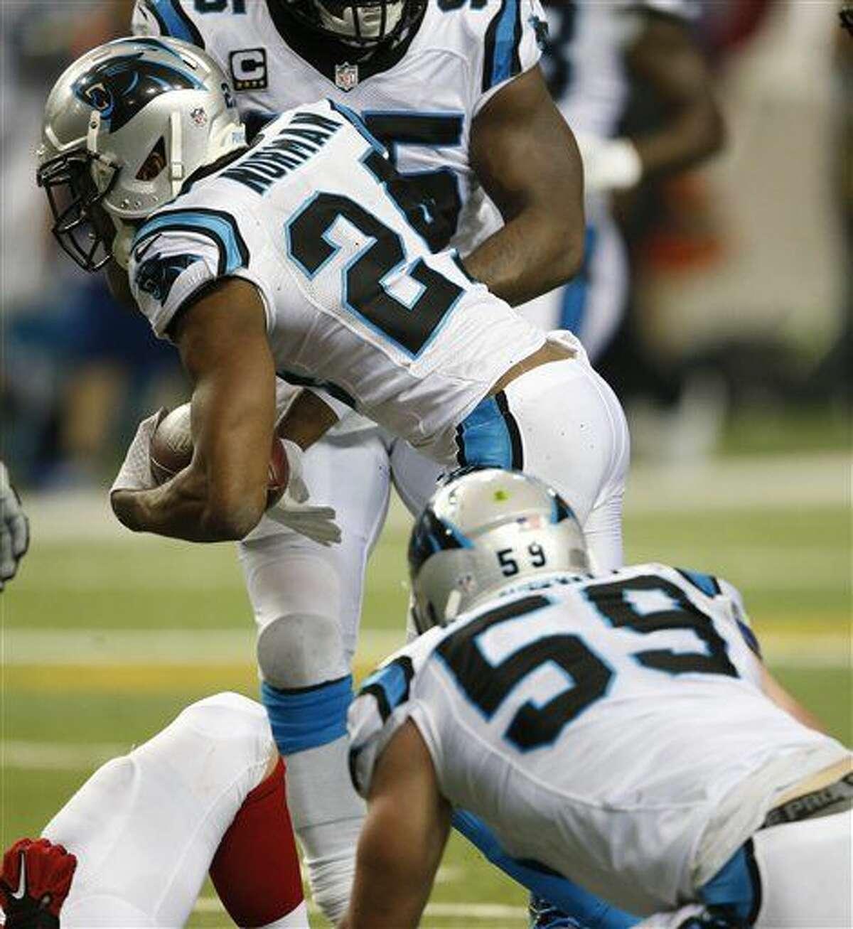 Carolina Panthers cornerback Josh Norman (24) recovers a loose ball against the Atlanta Falcons during the second half of an NFL football game, Sunday, Dec. 27, 2015, in Atlanta. (AP Photo/John Bazemore)