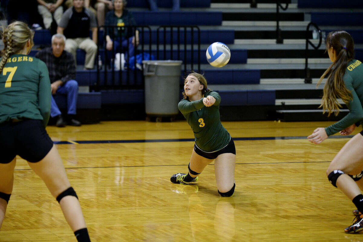 Dow High's Amanda Jones hits the ball during the third set on Tuesday at Mount Pleasant High School. Dow won the match.
