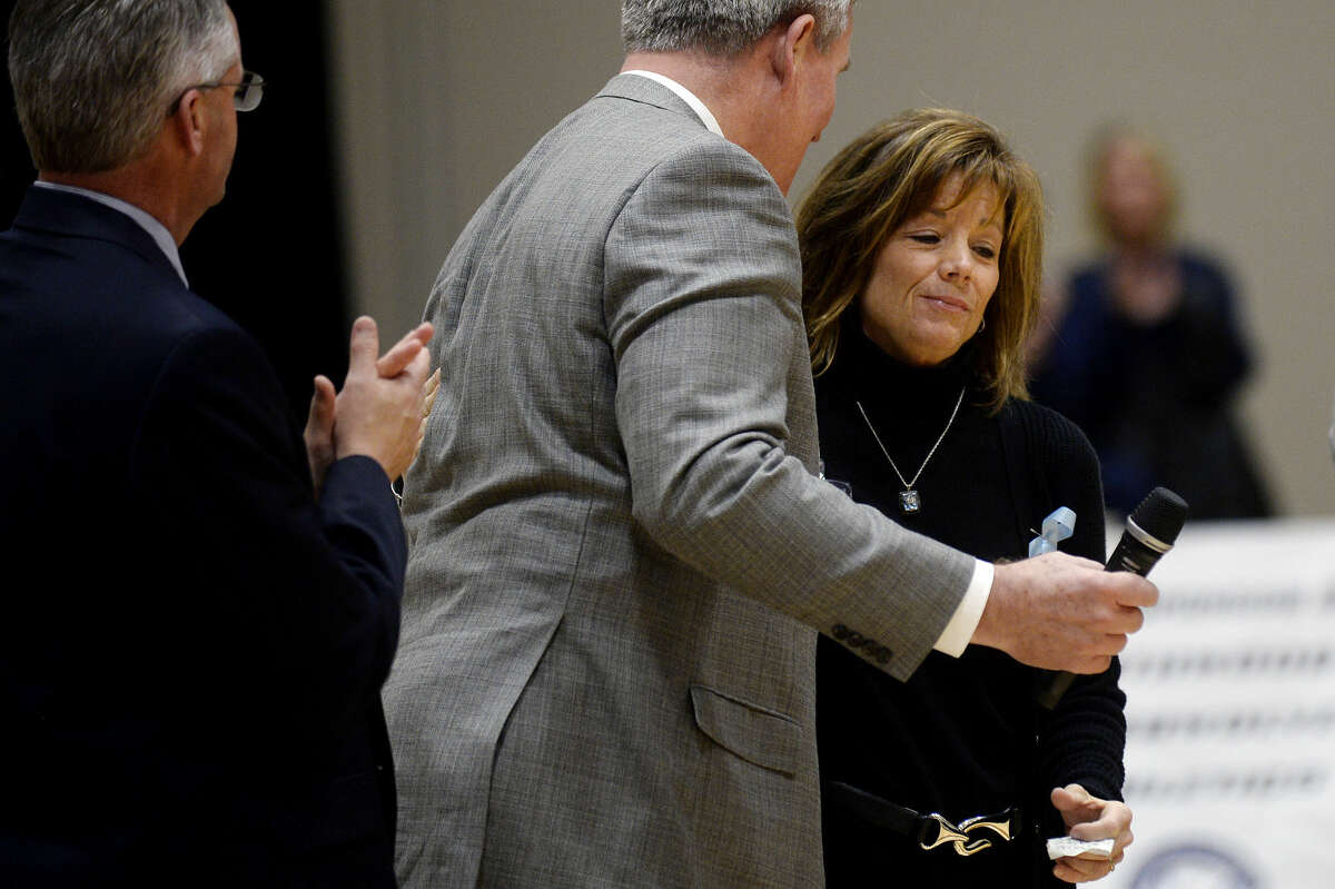 Sherri Riepma, wife of the late Northwood football coach Pat Riepma, hugs Northwood president and CEO Keith Pretty after she spoke during a dedication ceremony on Thursday at Northwood University. Northwood unveiled the new name Riepma Arena for the Bennett Sports Center arena during the ceremony.