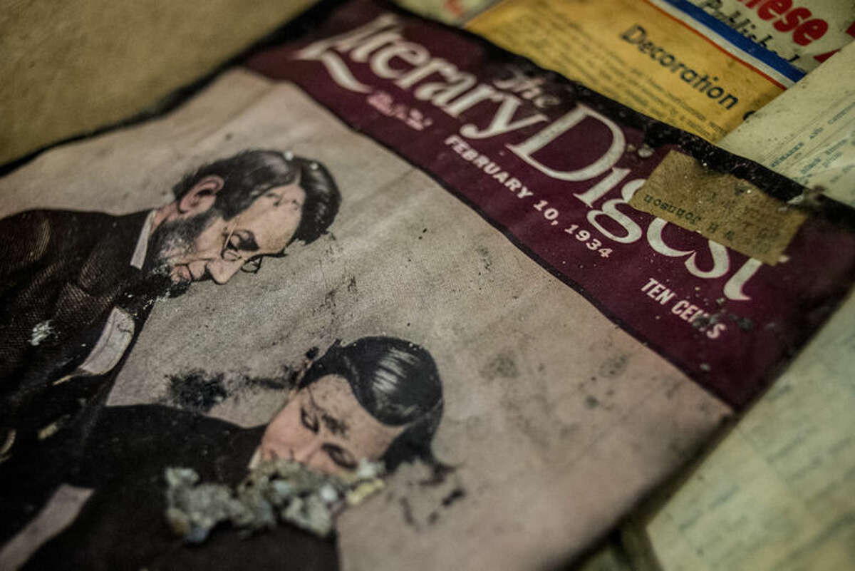A damaged publication dating back to February 1934 dries out at the Whaley Historic House Museum on Tuesday, Dec. 1, 2015, near downtown Flint, Mich., the day after a fire broke out in the third floor and on the roof, leaving heavy damage throughout the building. Museum president Thomas Henthorn says most of the museum's collections were on the other opposite side of the fire. But he noted that any damage to the house is significant because the house is an artifact. (Jake May/The Flint Journal-MLive.com via AP) LOCAL TELEVISION OUT; LOCAL INTERNET OUT; MANDATORY CREDIT