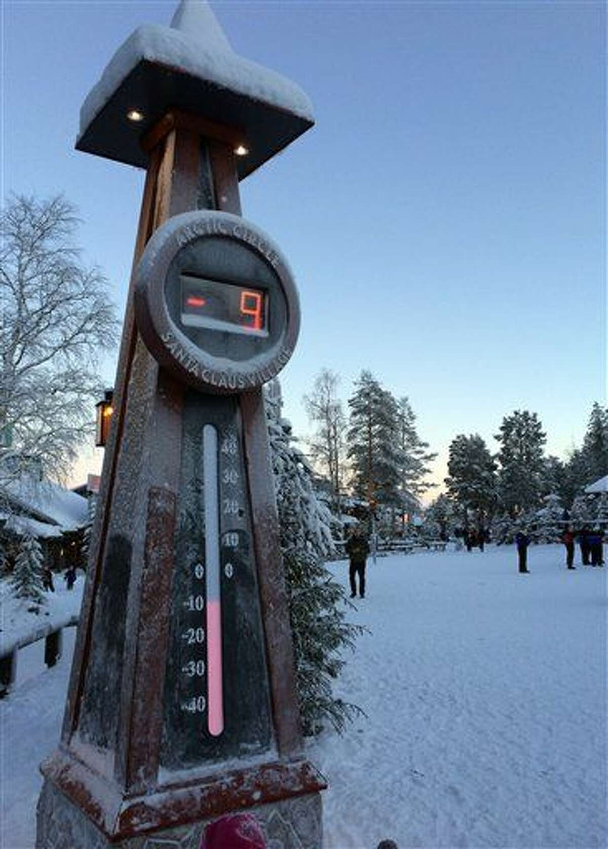 A thermometer reads minus-nine Celsius in Santa Claus Village, around 8 kms, 5 miles north of Rovaniemi in Finland on Tuesday Dec. 15, 2015. Most kids learn that Santa Claus comes from the North Pole, but children in Scandinavia are taught he lives a bit further south. Where exactly is a matter of much debate, with businesses in Finland, Sweden and Norway competing to cash in on the cache that comes with claiming Santa's hometown.(AP Photo/James Brooks)