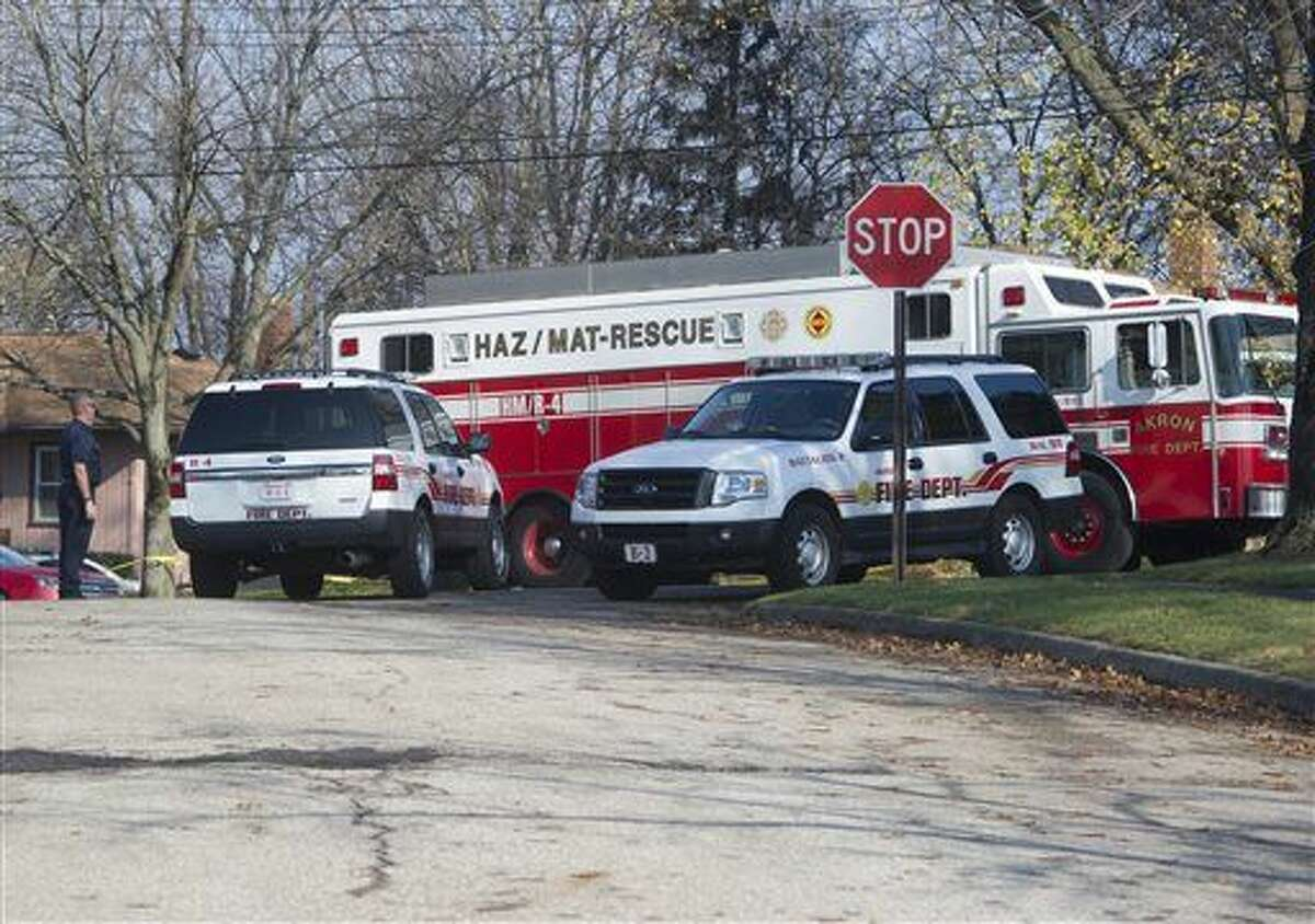 City of Akron, Ohio, fire and rescue workers continue the recovery process at the site of Tuesday's jet plane crash in Akron.