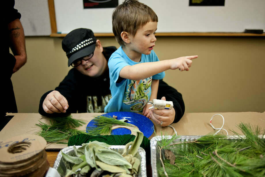 A youngster gets help making a holiday wreath during last year's Winter Solstice Celebration at the Chippewa Nature Center. This year, the Chippewa Nature Center will be hosting Winter Exploration Days Saturday through Jan. 3. Photo: Nick King | Nking@mdn.net