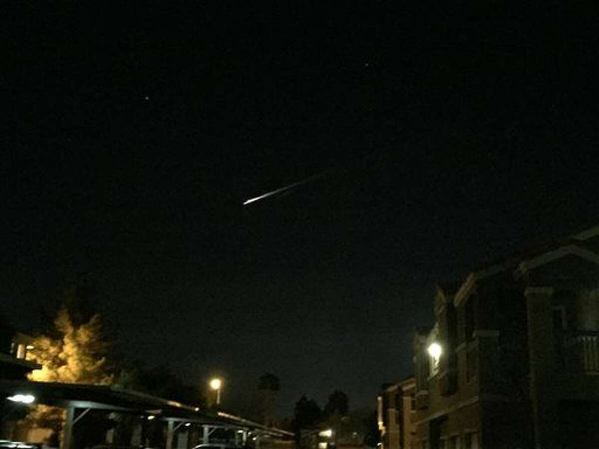 A streak of light is seen over an apartment complex in Las Vegas on Tuesday, Dec. 22, 2015. U.S. Military officials say the streak of light seen burning across the sky by people in three Western states was debris from a Russian rocket re-entering the atmosphere. (Gunnar Lindstrom via AP)