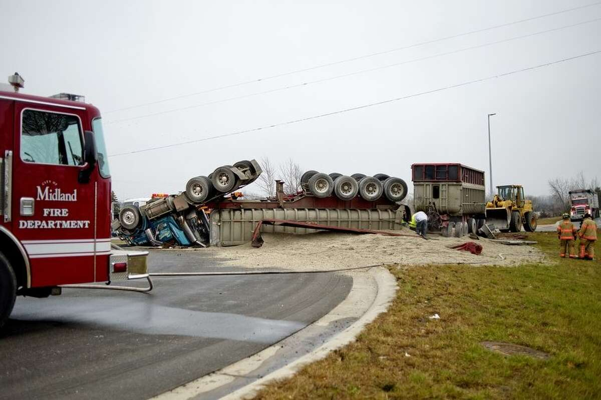 A tandem semi truck trailer crashed and overturned on the westbound Business 10 roundabout on Monday morning in Midland.