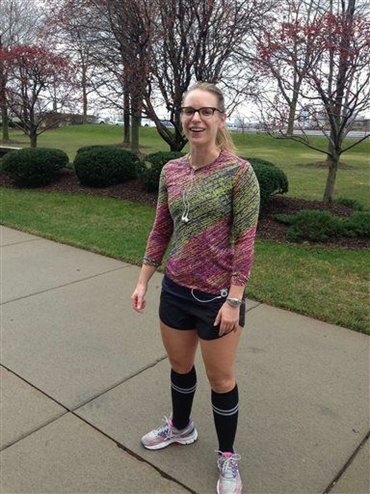 """Rheanne Suszek, 33, of Detroit, takes advantage of warm weather by running along Detroit's east riverfront Sunday. Suszek says on a typical December day in Michigan she would be wearing """"long, insulated running tights"""" while exercising outdoors."""