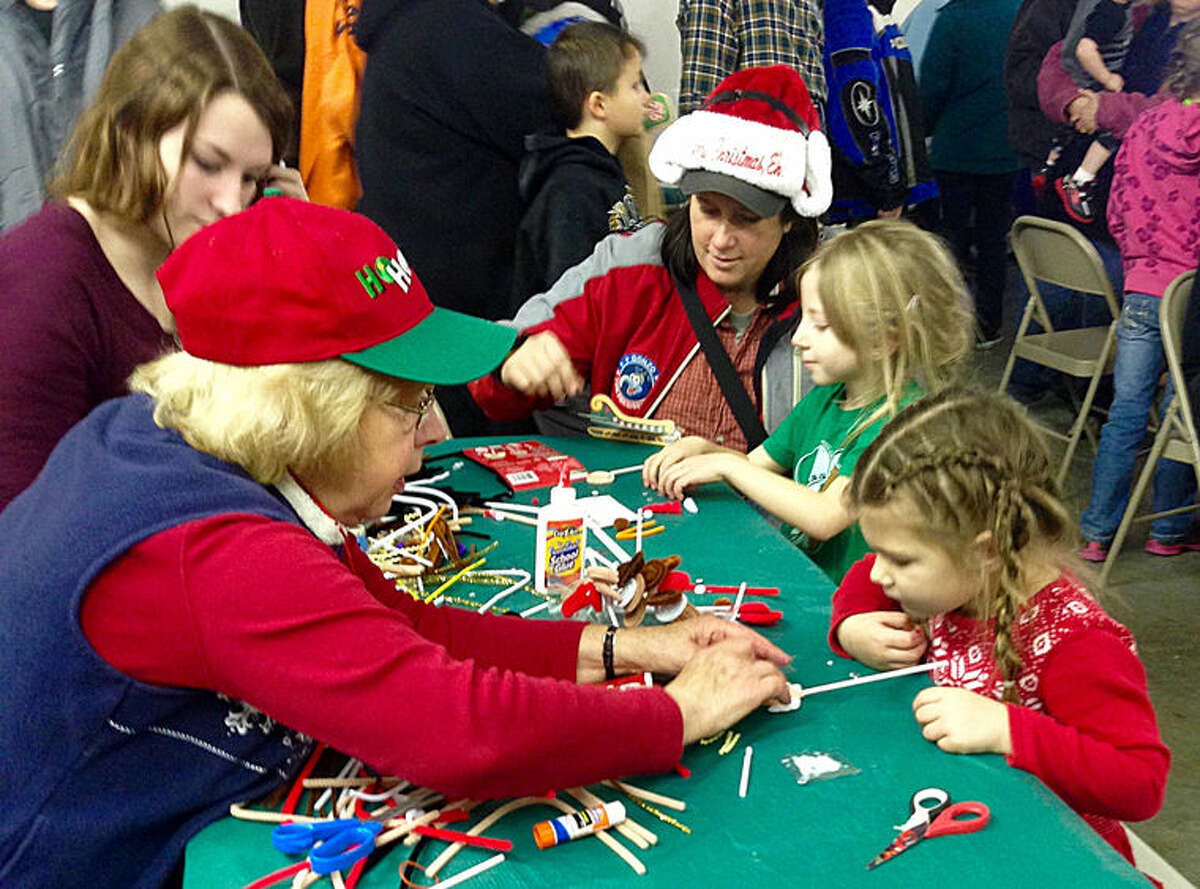 Donna Witkop helps children at the Midland Barstow Santa Fly-In.