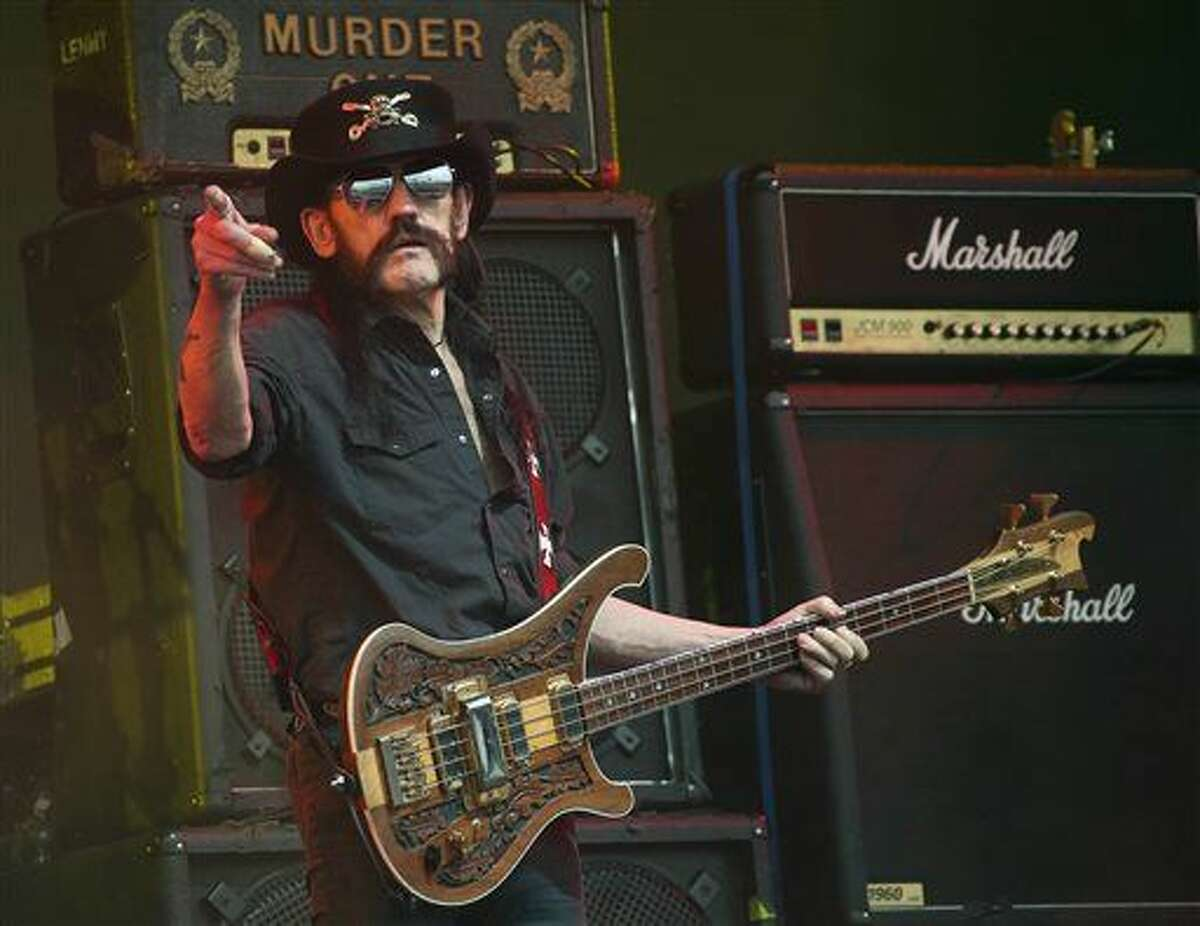 """FILE - This June 26, 2015 file photo shows Motorhead bassist Lemmy Kilmister performing on the Pyramid stage during Glastonbury Music Festival at Worthy Farm, Glastonbury, England. Ian """"Lemmy"""" Kilmister, the Motorhead frontman whose outsized persona made him a hero for generations of hard-rockers and metal-heads, has died on Monday, Dec. 28, 2015. (Photo by Joel Ryan/Invision/AP, file)"""