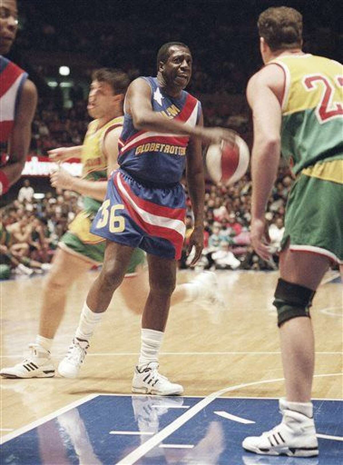 """FILE - In this Feb. 13, 1993, file photo, legendary Harlem Globetrotters' Meadowlark Lemon prepares to put the moves on Washington Generals' Tim Burkhart during their basketball game at Madison Square Garden in New York. Lemon, known as the Globetrotters' """"clown prince"""" of basketball, died Sunday, Dec. 27, 2015, in Scottsdale, Ariz. He was 83. (AP Photo/Bebeto Matthews, File)"""