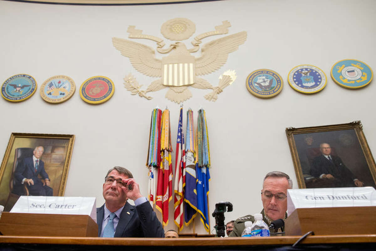 Defense Secretary Ash Carter, left, and Joint Chiefs Chairman Gen. Joseph Dunford Jr., appear on Capitol Hill in Washington, Tuesday, Dec. 1, 2015, before the House Armed Services Committee hearing on the U.S. Strategy for Syria and Iraq and its Implications for the Region. (AP Photo/Andrew Harnik)