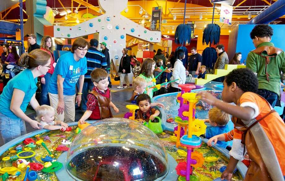 Visitors are seen at the Mid-Michigan Children's Museum in Saginaw in this Daily News file photo. The children's museum has several activities planned during the holidays. Photo: Lamont Lenar | Daily News File Photo