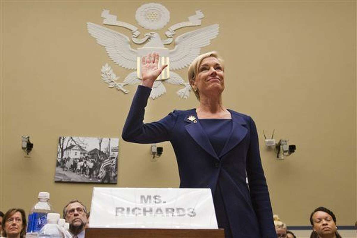 """In this file photo, Planned Parenthood Federation of America President Cecile Richards is sworn in before testifying at a House Committee on Oversight and Government Reform Hearing on """"Planned Parenthood's Taxpayer Funding,"""" in Washington. Responding to a furor over undercover videos, Planned Parenthood said today it will maintain programs at some of its clinics that make fetal tissue available for research, but will no longer accept any sort of payment to cover the costs of those programs."""