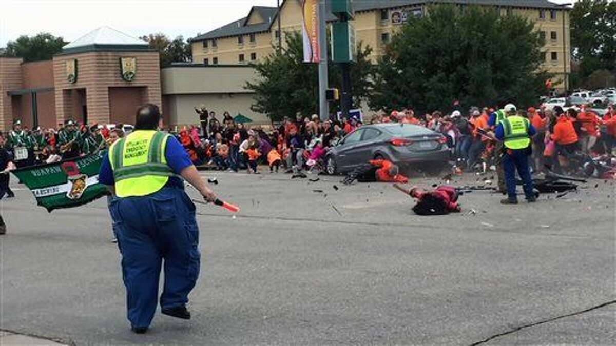 This Oct. 2file image taken from video shows the scene in Stillwater, Okla. as a car crashes into spectators at Oklahoma State University's homecoming parade. On Wednesday, Payne County District Attorney Laura Thomas formally charged Adacia Chambers with four counts of second-degree murder and 46 counts of felony assault.