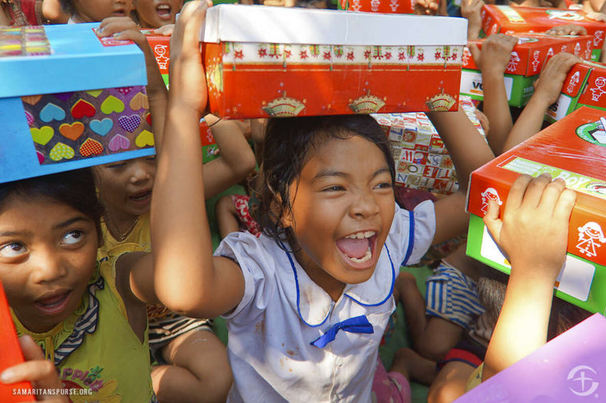 The excitement can be seen on this child's face after receiving a shoebox filled with gifts through the Samaritan's Purse program Operation Christmas Child.