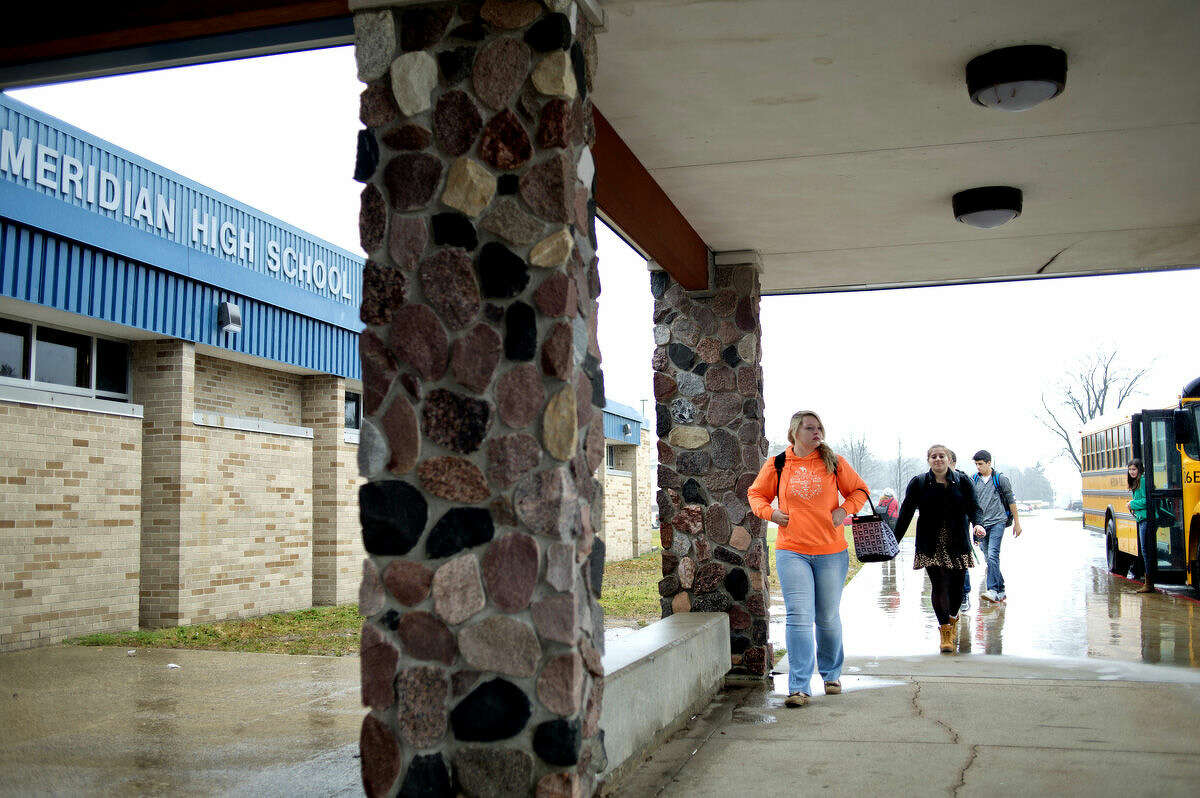 Meridian students exit a bus that brought them back to school from Delta College where the take classes as part of Meridian's Early College program. Approximately 100 students attend classes at Delta and Bay Arenac through the program. The school provides transportation, tuition and books to the students.
