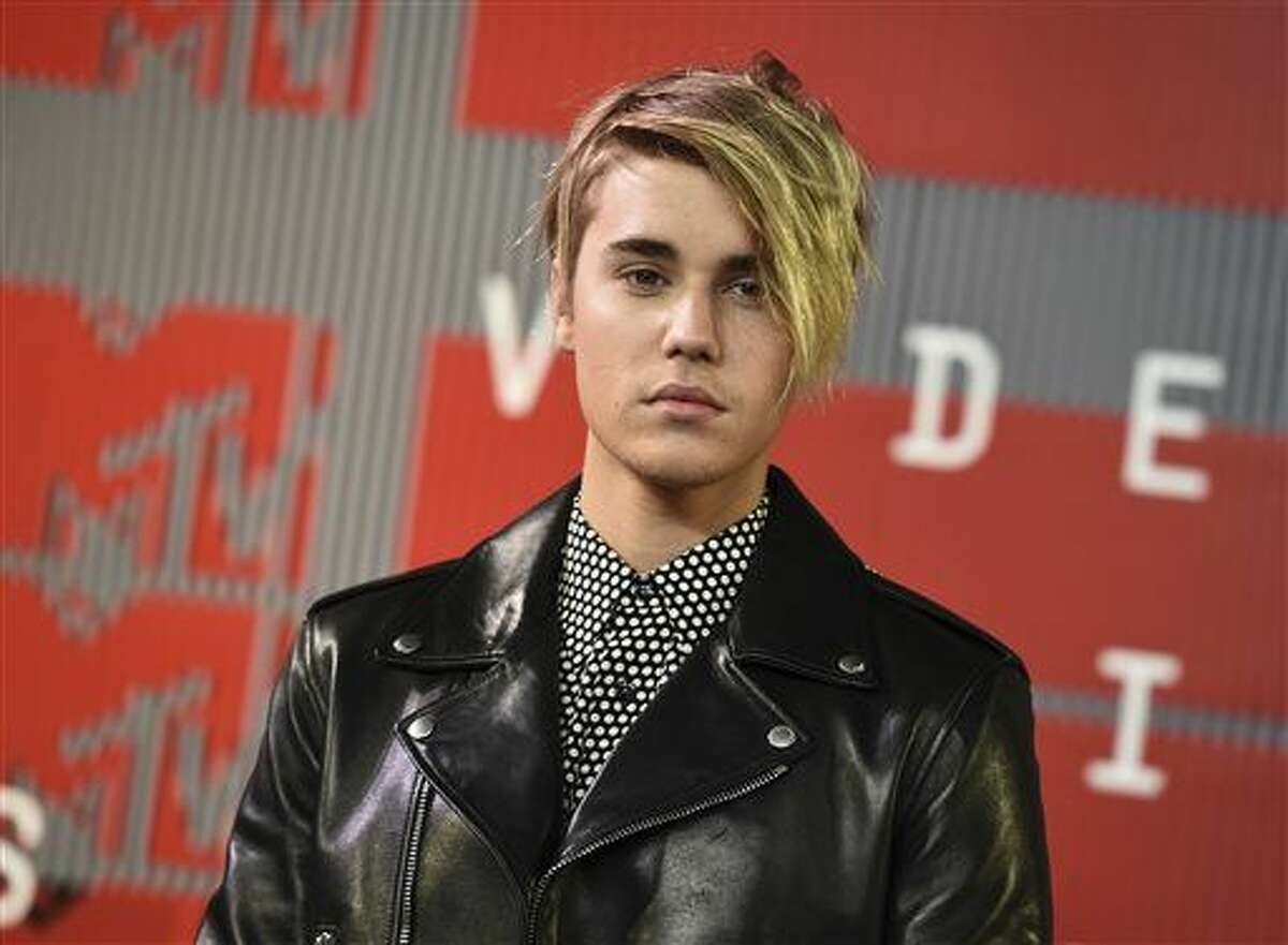"""In this Aug. 30 file photo, Justin Bieber arrives at the MTV Video Music Awards in Los Angeles. Bieber celebrated the release of his new album, """"Purpose,"""" with a fan event on Friday."""
