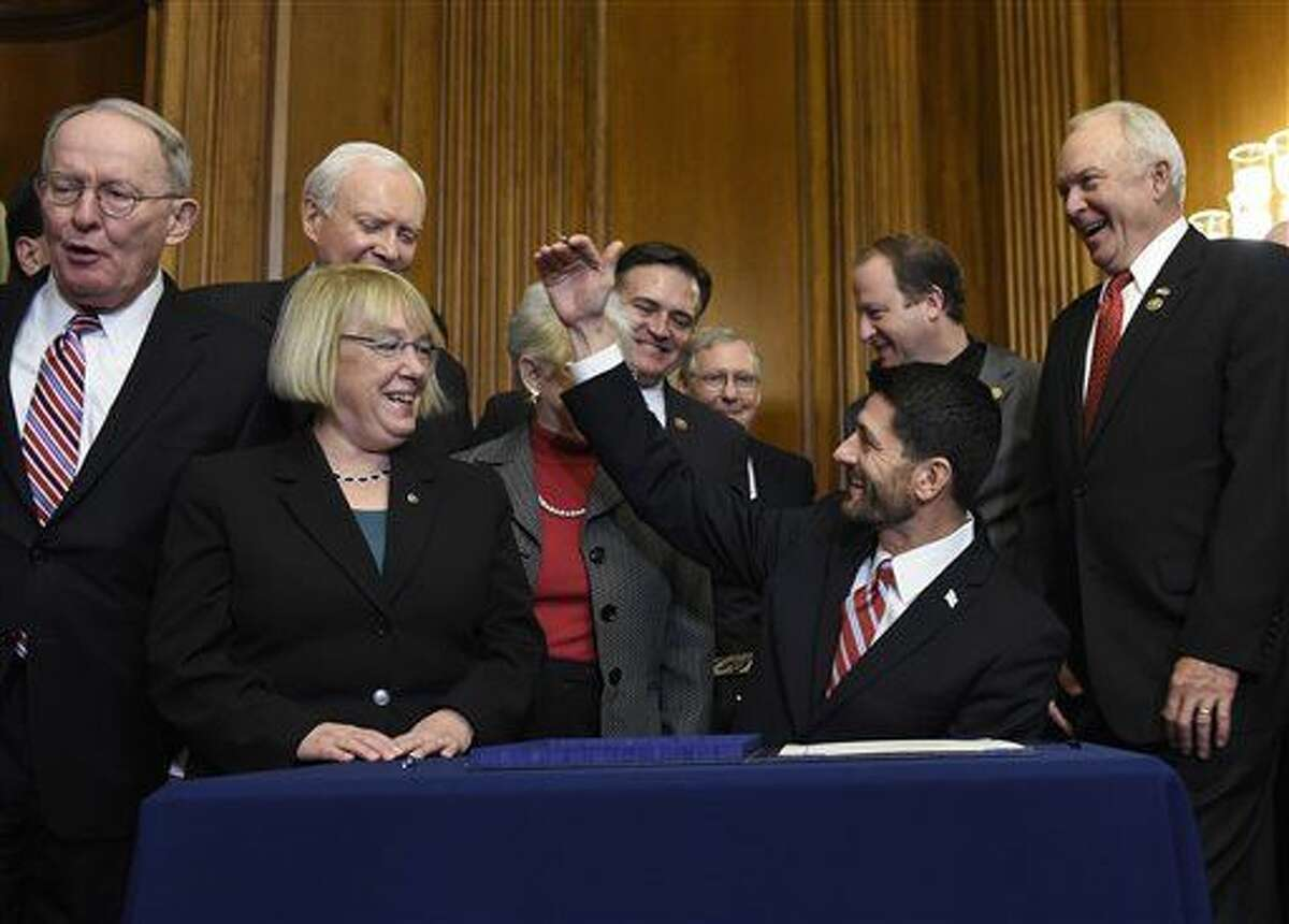 House Speaker Paul Ryan of Wis., sits down to sign legislation on Capitol Hill in Washington, Wednesday, Dec. 9, 2015, that changes how the nation's public schools are evaluated, rewriting the landmark No Child Left Behind education law of 2002. From left are. Senate Health, Education, Labor and Education Committee Chairman Sen. Lamar Alexander, R-Tenn., the committee's ranking member Sen. Patty Murray, D-Wash., and Sen. Orrin Hatch, R-Utah, (AP Photo/Susan Walsh)