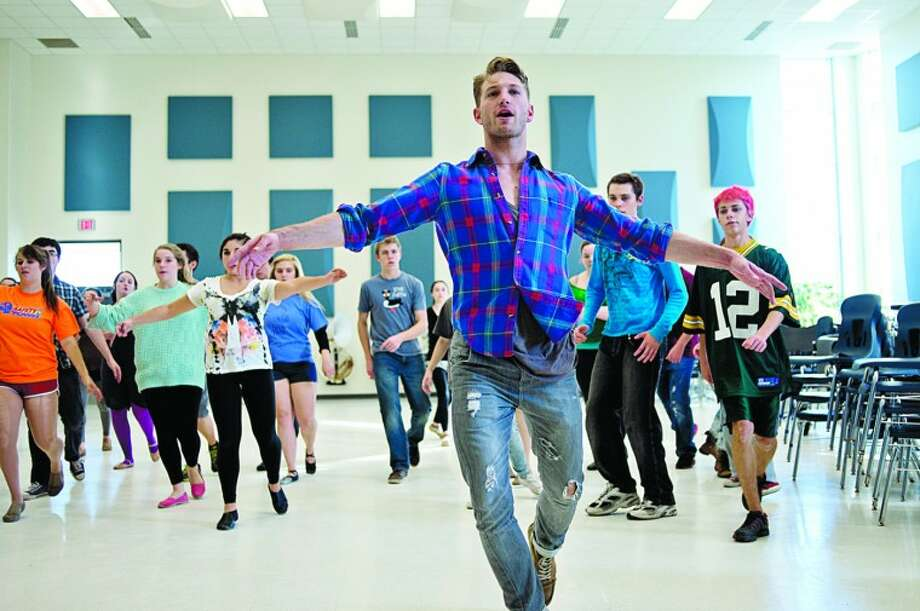 NICK KING | nking@mdn.net Professional dancer and soloist Eric Bourne, from Midland, works with a class of Midland High School students during a Rhapsody practice on Tuesday. Bourne talked to students about his career and give dancing tips during practice. Photo: Nick King/Midland  Daily News