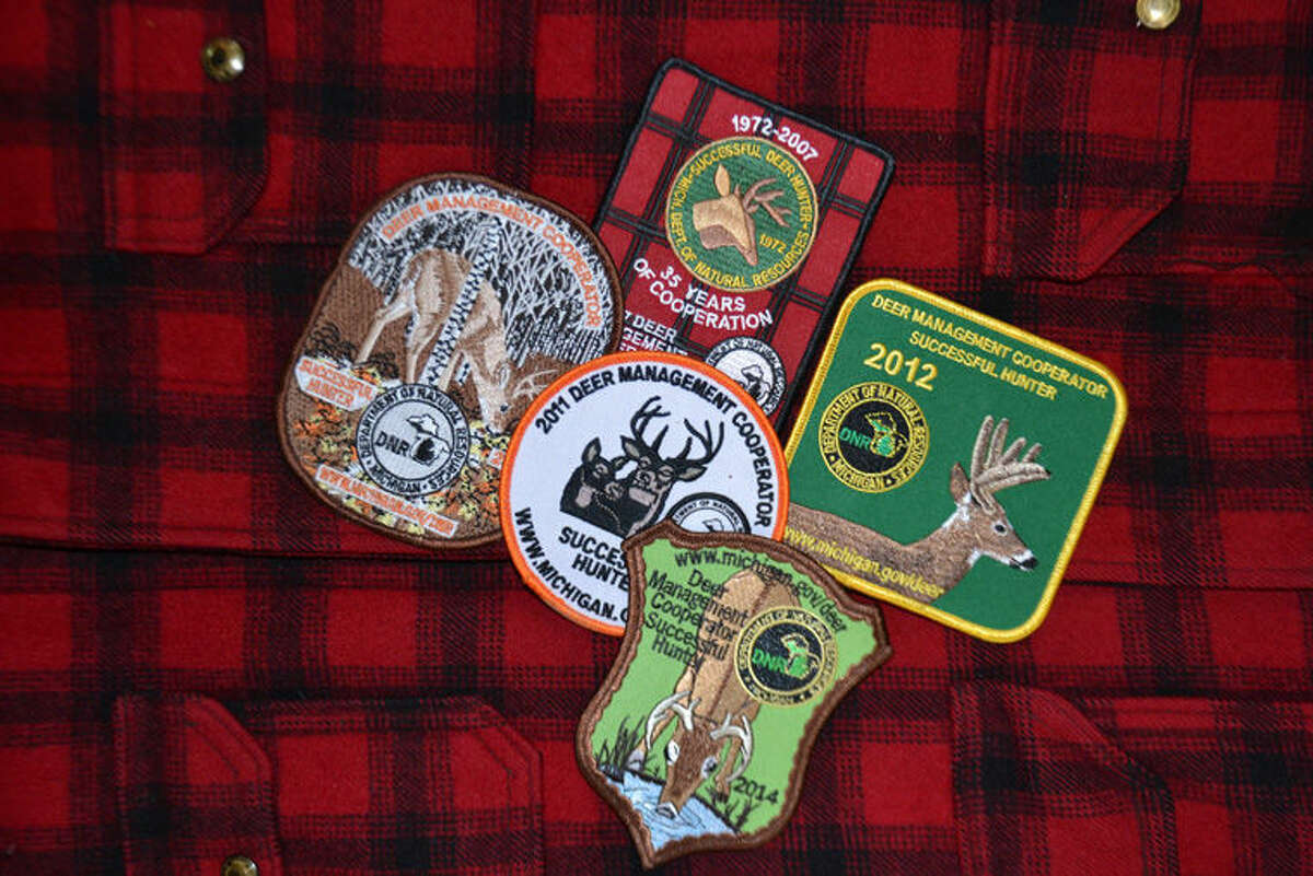 Pictured are DNR successful hunter patches from past years.