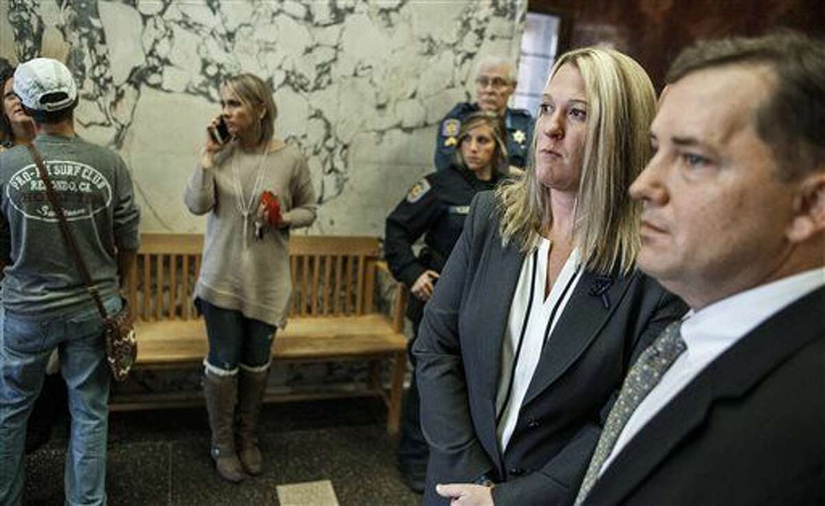 Lisa Mearkle stands next to her attorney Brian Perry before speaking to the media at the Dauphin County Courthouse after she was acquitted Thursday, Nov. 5, 2015, at her murder trial in Harrisburg, Pa. A jury found Hummelstown police Officer Mearkle not guilty on all charges on the third day of her murder trial. Mearkle was charged with third-degree murder, voluntary manslaughter and involuntary manslaughter for the fatal February shooting of 59-year-old David Kassick.