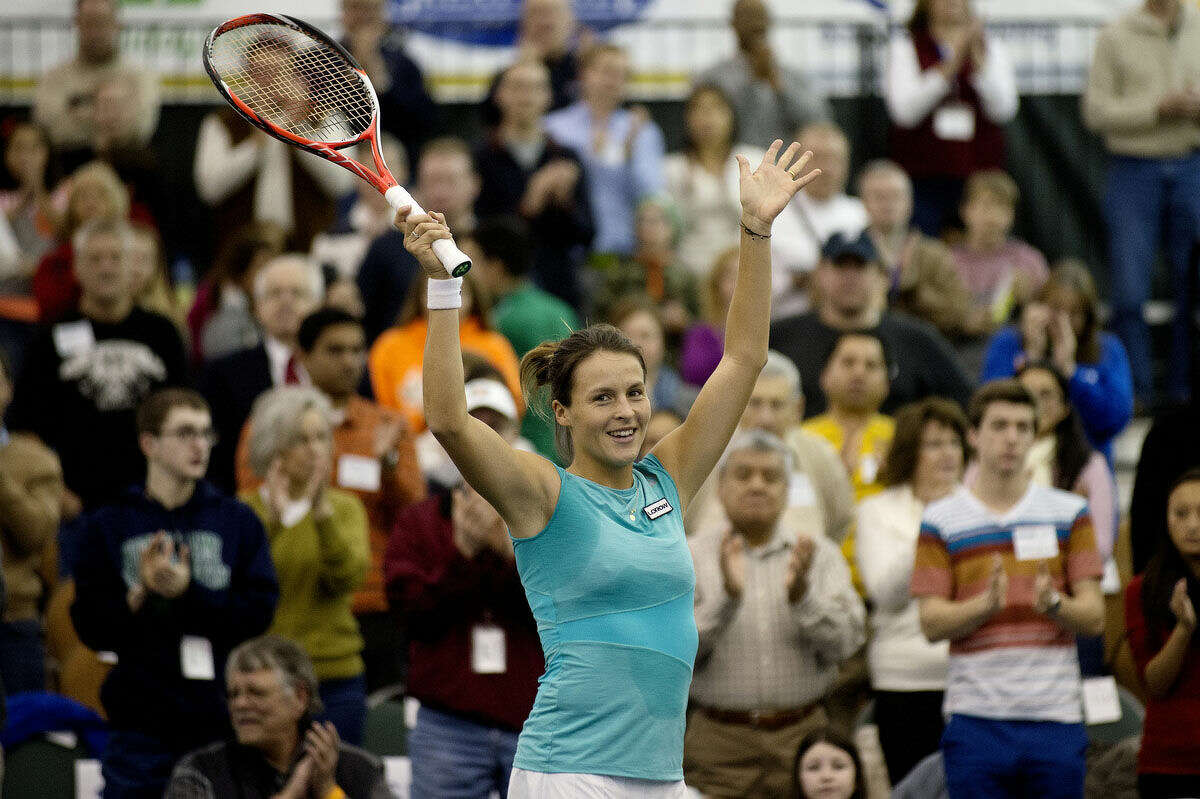 Tatjana Maria celebrates after defeating Louisa Chirico in the singles final match at last year's Dow Corning Tennis Classic. On Dec. 1, known globally as #GIVINGTUESDAY, the tournament will donate 10 percent of total ticket sales to Girls on the Run Midland and Girls on the Run Saginaw Bay.