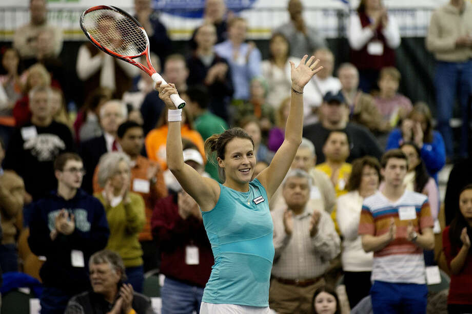 Tatjana Maria celebrates after defeating Louisa Chirico in the singles final match at last year's Dow Corning Tennis Classic. On Dec. 1, known globally as #GIVINGTUESDAY, the tournament will donate 10 percent of total ticket sales to Girls on the Run Midland and Girls on the Run Saginaw Bay. Photo: NICK KING | Nking@mdn.net