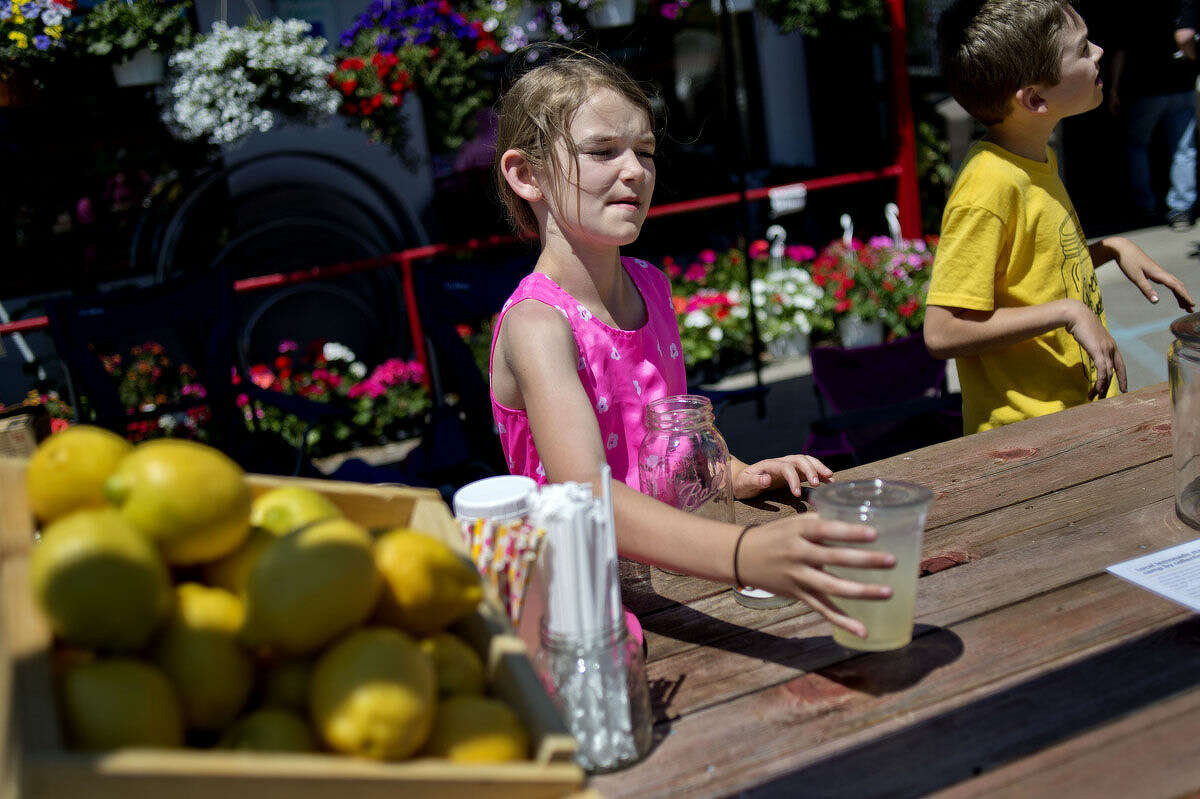 In this file photo, Sydney Damude and her brother Easton, 9, offer lemonade for donations to the Mid-Michigan Royal Family Kids Camp. The youths are being honored tonight for their fundraising efforts.