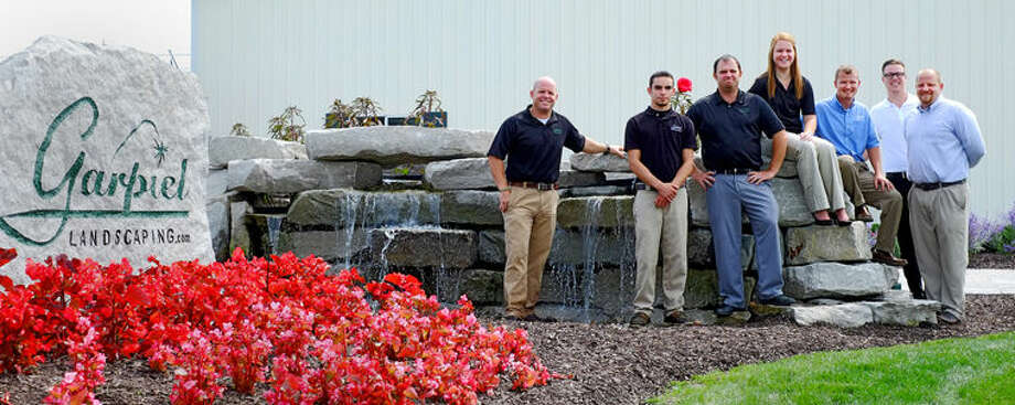 The Garpiel Landscaping staff pose at the Auburn business in this Daily News file photo. Rob Garpiel, founder and president, is pictured at far left. Photo: Photo Provided