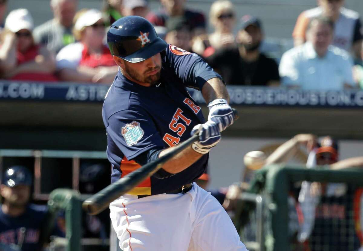 Houston Astros Tyler White bats against the St. Louis Cardinals in a spring training baseball game, Friday, March 4, 2016, in Kissimmee, Fla. (AP Photo/John Raoux)