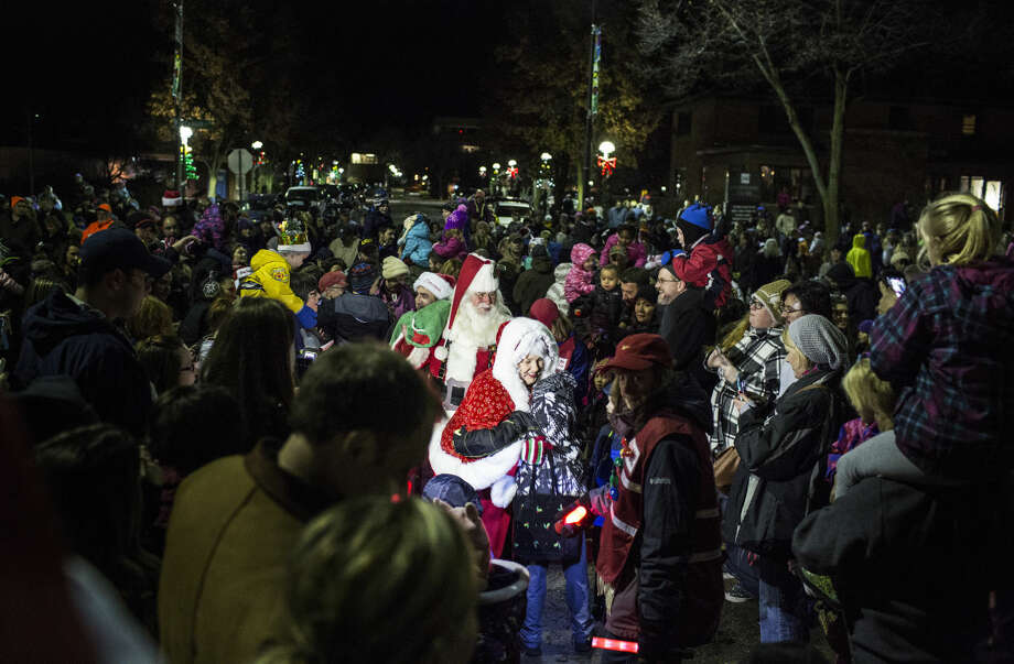 THEOPHIL SYSLO | For the Daily News Santa and Mrs. Claus hug and shake hands while climbing the steps to the Midland County Courthouse while participating in Midland's annual courthouse lighting ceremony Tuesday evening. Photo: Theophil Syslo