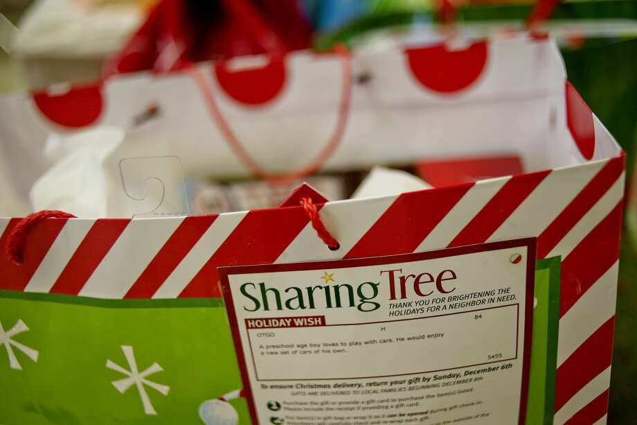 FILE - The Sharing Tree logo and a description of the gift is pasted on a bag as volunteers from various agencies gather gifts for distribution as part of the United Way of Midland County Sharing Tree program at Blessed Sacrament Church. Photo: Nick King/Midland Daily News