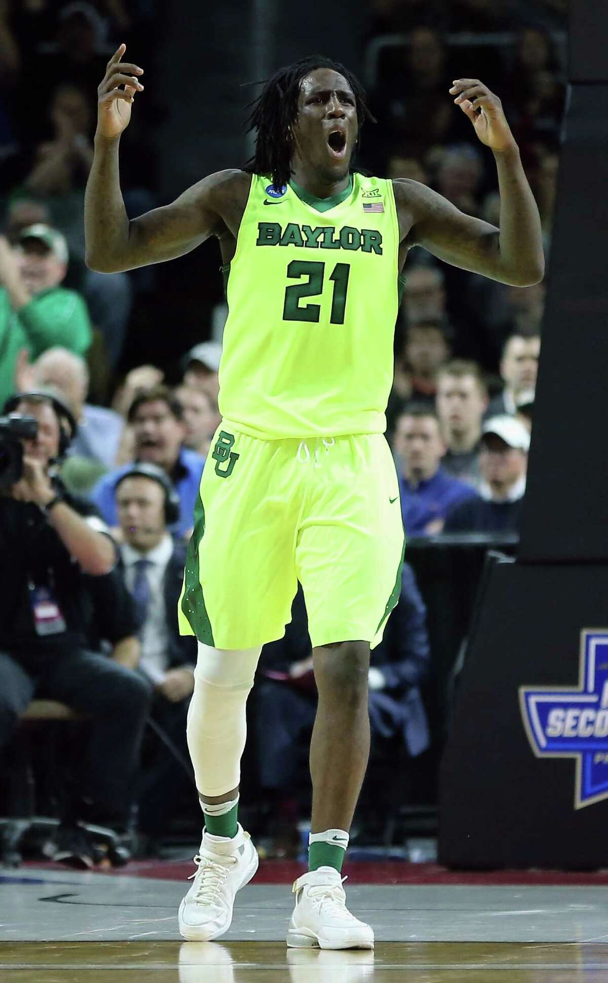 PROVIDENCE, RI - MARCH 17: Taurean Prince #21 of the Baylor Bears reacts in the first half against the Yale Bulldogs during the first round of the 2016 NCAA Men's Basketball Tournament at Dunkin' Donuts Center on March 17, 2016 in Providence, Rhode Island.
