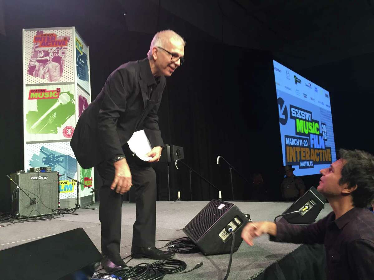 Record producer Tony Visconti interacts with a fan at SXSW.