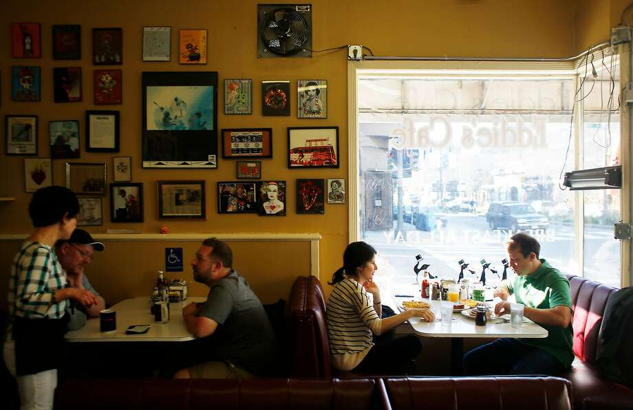 Romina Finn (second from right) and Jamie Finn (right) enjoy a meal at Eddie's Cafe as Helen Hwang (right) waits on customers on Thursday, March 17, 2016 in San Francisco, California. Photo: Lea Suzuki / The Chronicle
