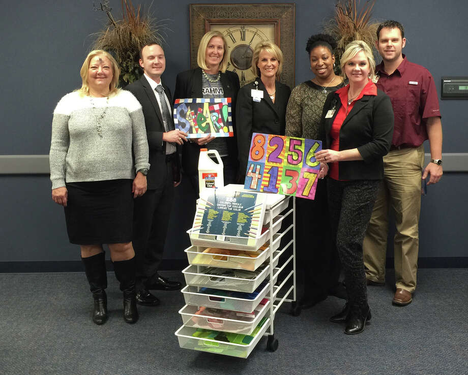 Representatives from SpringHill Suites by Marriott and Cypress-Fairbanks Independent School District review the hotel's art supply donations to Bleyl Middle School. From left are SpringHill Suites by Marriott sales director Olga Maciques; SpringHill Suites by Marriott general manager Nicholas Albers; Bleyl art teacher Kathleen Cotton-Windham; Cy-Fair ISD marketing and business relations director Leslie Francis; Bleyl academic achievement specialist Samdria Stewart; Bleyl director of instruction Colette Maxwell; and Bleyl Assistant Principal Matt Ebner. Photo: Cypress-Fairbanks ISD