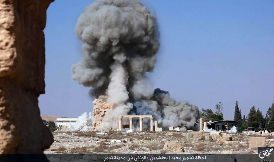 This undated photo on a social media site used by Islamic State militants, which has been verified and is consistent with other AP reporting, shows smoke from the detonation of the 2,000-year-old temple of Baalshamin in Syria's ancient caravan city of Palmyra. The Islamic State benefits from opposition that is either too much cautious or rash. Photo: Uncredited /AP / militant social media account