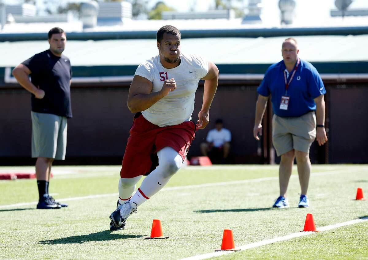 Offensive lineman Joshua Garnett participates in drills during Stanford University's Pro Day on campus in Palo Alto, California, on Thursday, March 17, 2016.