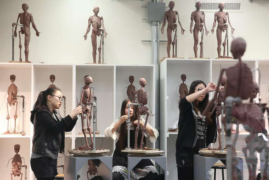 Students in the Academy of Art's school of fine art work on sculptures at the Cannery. Photo: Liz Hafalia, The Chronicle