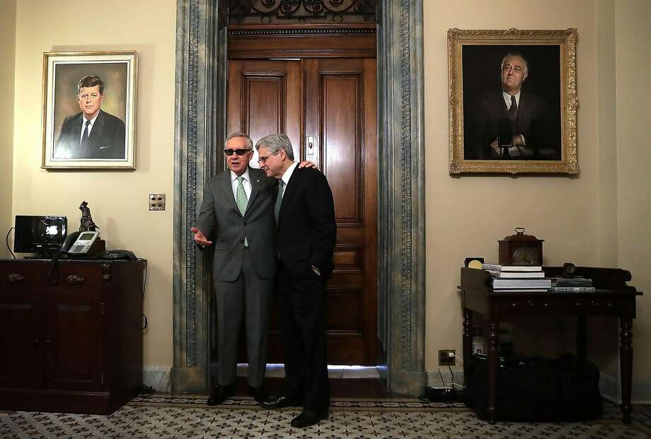 Senate Minority Leader Sen. Harry Reid meets with Supreme Court nominee Merrick Garland on Capitol Hill. Photo: Alex Wong, Getty Images