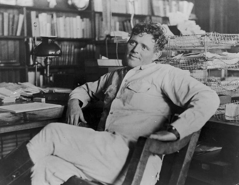 Jack London strikes a jaunty pose next to his desk.  Photo: Hulton Archive, Getty Images