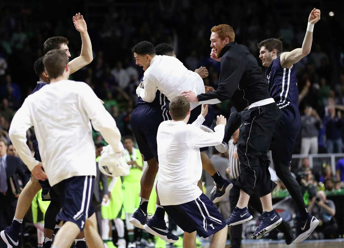 PROVIDENCE, RI - MARCH 17: The Yale Bulldogs celebrate defeating the Baylor Bears 79-75 during the first round of the 2016 NCAA Men's Basketball Tournament at Dunkin' Donuts Center on March 17, 2016 in Providence, Rhode Island.