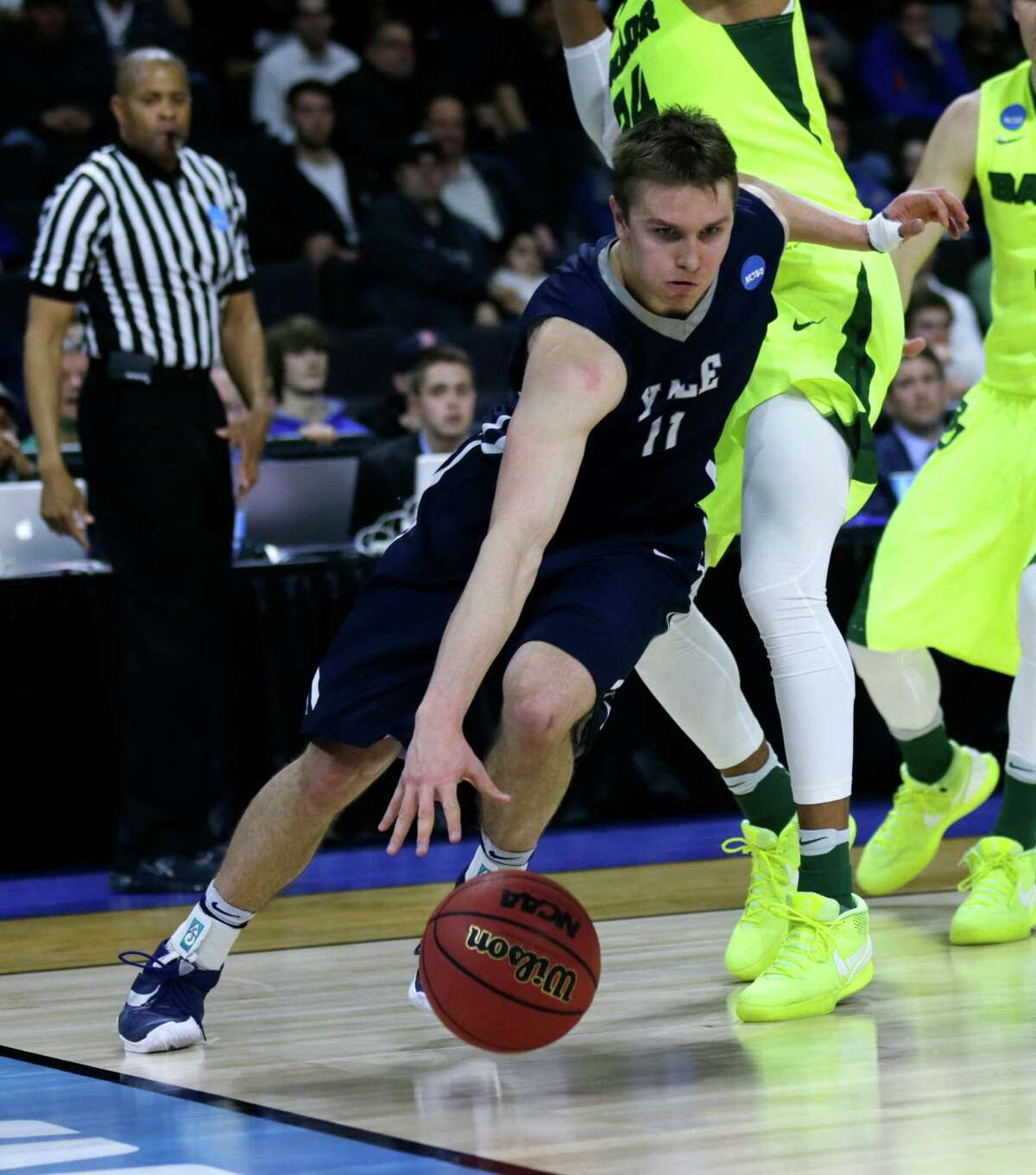 Yale guard Makai Mason (11) in the second half during the first round of the NCAA college men's basketball tournament in Providence, R.I., Thursday, March 17, 2016. Yale defeated Baylor 79-75.